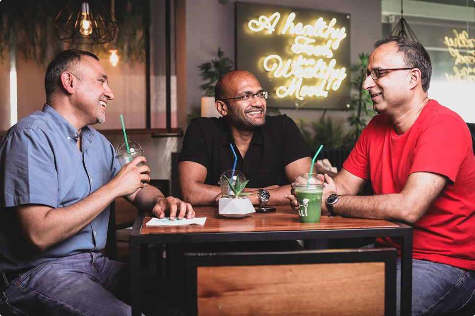 three founders of VentureDive dining out and laughing - Shehzad Nakhoda, Atif Azim, Saad Fazil